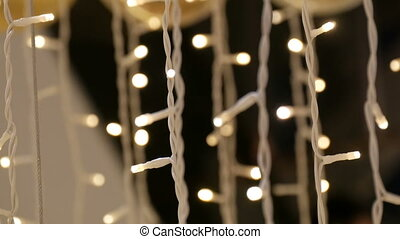 Christmas garland with Golden lights, in mall close-up....