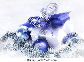 Christmas gift and blue Christmas balls on a festive white back