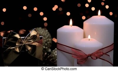 Christmas gift and candles in atmospheric light - Christmas ...