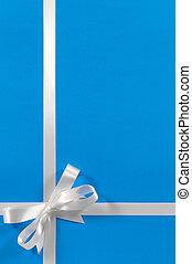 Christmas gift border white gift ribbon bow blue background vertical