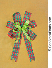 Christmas gift bow on brown paper