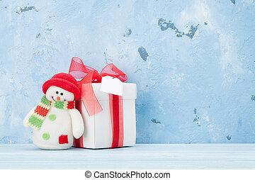 Christmas gift box and snowman