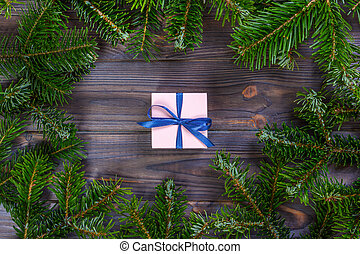 Christmas gift box. Christmas present at white wooden table. Flat lay with copy space