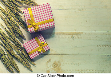 Christmas gift box. Christmas present in box at white wooden table.