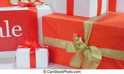 Christmas gift box in female hands pan shot