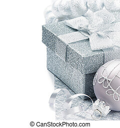Christmas gift box with festive decoration in silver tone