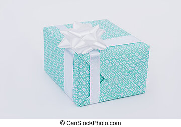 Christmas gift box with white bow isolated.
