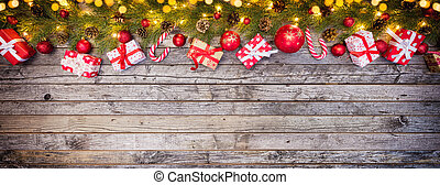 Christmas gift boxes placed on wooden planks. Copyspace for...