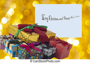 Christmas gift boxes with beautiful greeting card on the background