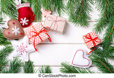 Christmas gift boxes with red ribbon on white background with Fir branches. Xmas and Happy New Year composition. Horizontal, top view