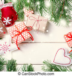 Christmas gift boxes with red ribbon on white background with Fir branches. Xmas and Happy New Year composition. Square, top view