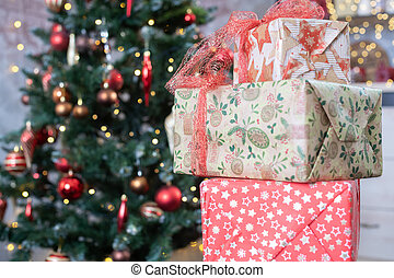Christmas gift boxes with tree on background