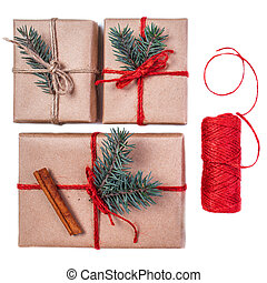 Christmas gift boxes wrapped in craft paper isolated on white background. Holiday greeting card concept