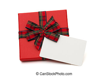 Christmas gift with a blank card isolated on white