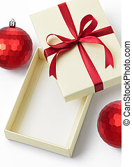 christmas gift - empty gift box with christmas baubles on...