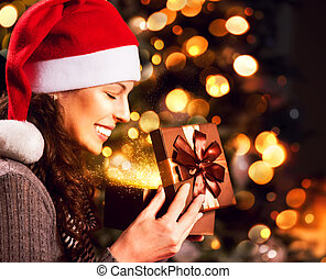 Christmas Gift. Happy Surprised Woman opening Giftbox