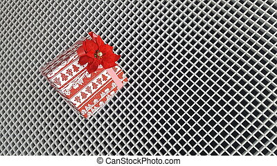 Christmas Gift in a bright package with a beautiful bow on the background of the lattice with small cells. The concept of the new year holiday.