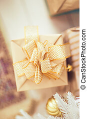 Christmas gift in craft paper and gold ribbon