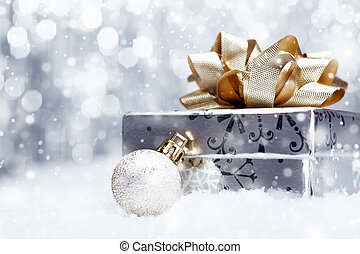 Christmas gift in falling snow