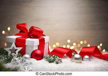 Christmas gift in snow, elegant background