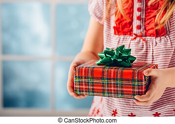 Christmas gift in the hands of a child. Shallow dof