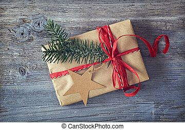 Christmas gift on a wooden background