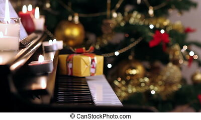 Christmas gift on piano. Christmas tree and decoration with gift on piano.