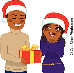 Christmas Gift Present - Cute African American man giving...