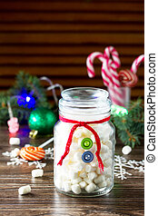 Christmas gift snowman sweets marshmallows in a jar. Made by own hands. Children's art project for children. Craft for kids. Copy space for text.