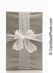 Christmas gift. - Still life of large silver wrapped...