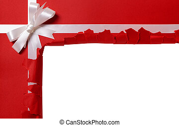 Christmas gift torn open, white ribbon bow, red wrapping...