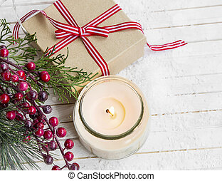 Christmas gift with decorations and scented candle , festive setting