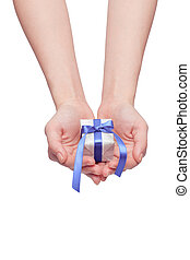 christmas gift with decorative blue ribbon bow