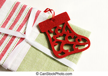 Christmas gift wrapped in fabric and ribbon.