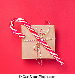 Christmas giftbox decorated with candy cane