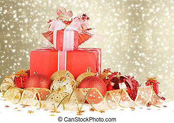 Christmas gifts and balls with gold ribbon on a beautiful abstra