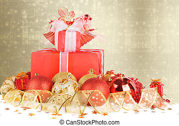Christmas gifts and balls with gold ribbon on a beautiful abstract background
