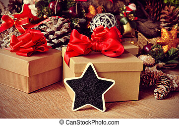 christmas gifts and blank star-shaped chalkboard