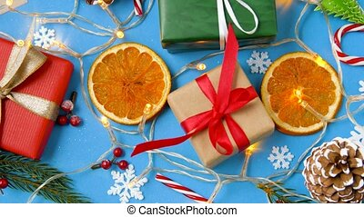 christmas gifts and decorations on blue background -...