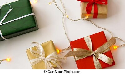 christmas gifts and garland on white background - christmas...