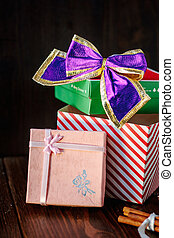 Christmas gifts and presents on wooden table.