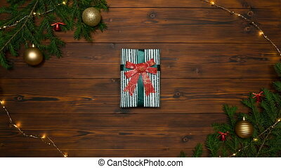 Christmas gifts changing inside of pine branches frame. Stop motion