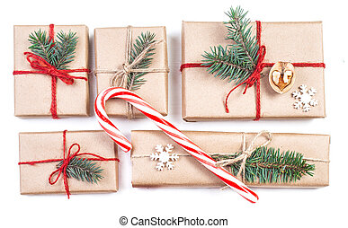 Christmas gifts, fir tree branches, xmas holiday decorations, festive symbols isolated on white background with copyspace. Christmas composition.