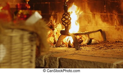 christmas gifts fireplace backgroun - decorated wicker...