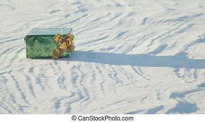 Christmas gifts in a field on snow in a sunny, frosty and clear weather outdoors. Animation of emerging gifts. Cartoon.