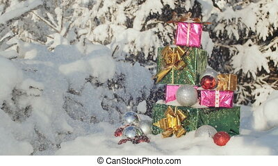 Christmas gifts in the snow-covered forest. New Year theme.