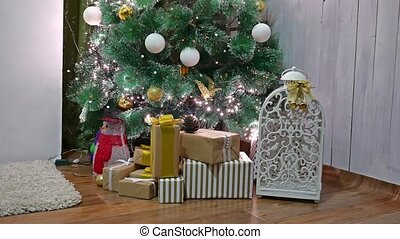Christmas gifts interior tree and New Year toys room blinking lights and fireplace