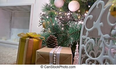 Christmas gifts interior tree room and New Year toys blinking lights and fireplace