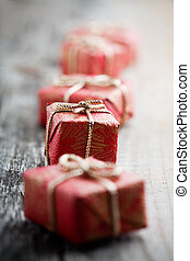 Little christmas gifts on old wooden background