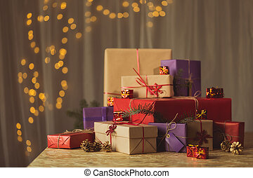 Christmas gifts lying on table